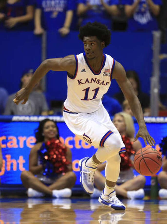 FILE - In this Nov. 1, 2016, file photo, Kansas guard Josh Jackson moves down court during the first half of an exhibition NCAA college basketball game against Washburn, in Lawrence, Kan. No. 3 Kansas has guard Josh Jackson, the nation's No. 1 prospect in his class according to the 247Sports Composite. (AP Photo/Orlin Wagner, File)