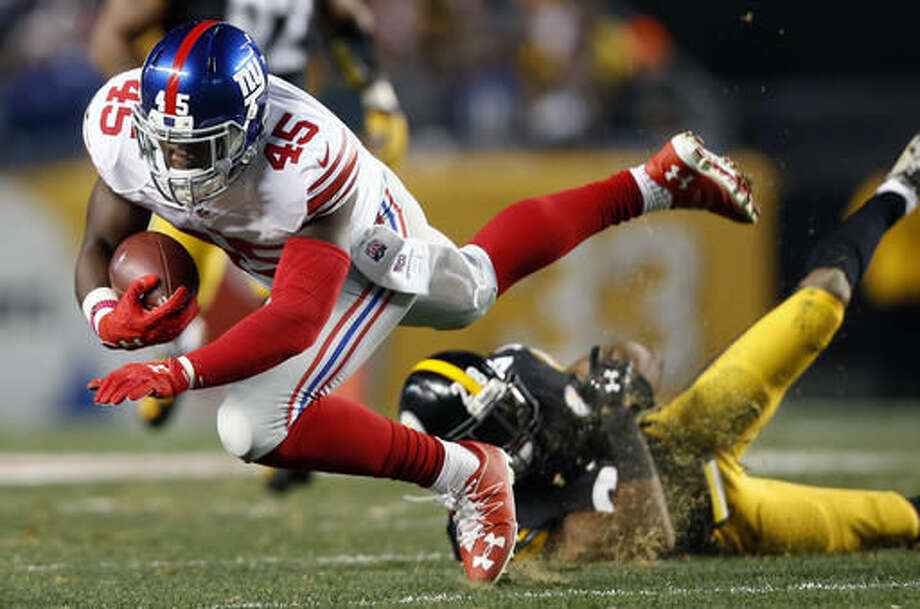 New York Giants tight end Will Tye (45) is tackled by Pittsburgh Steelers defensive back Cortez Allen (28) during the first half of an NFL football game in Pittsburgh, Sunday, Dec. 4, 2016. (AP Photo/Jared Wickerham)
