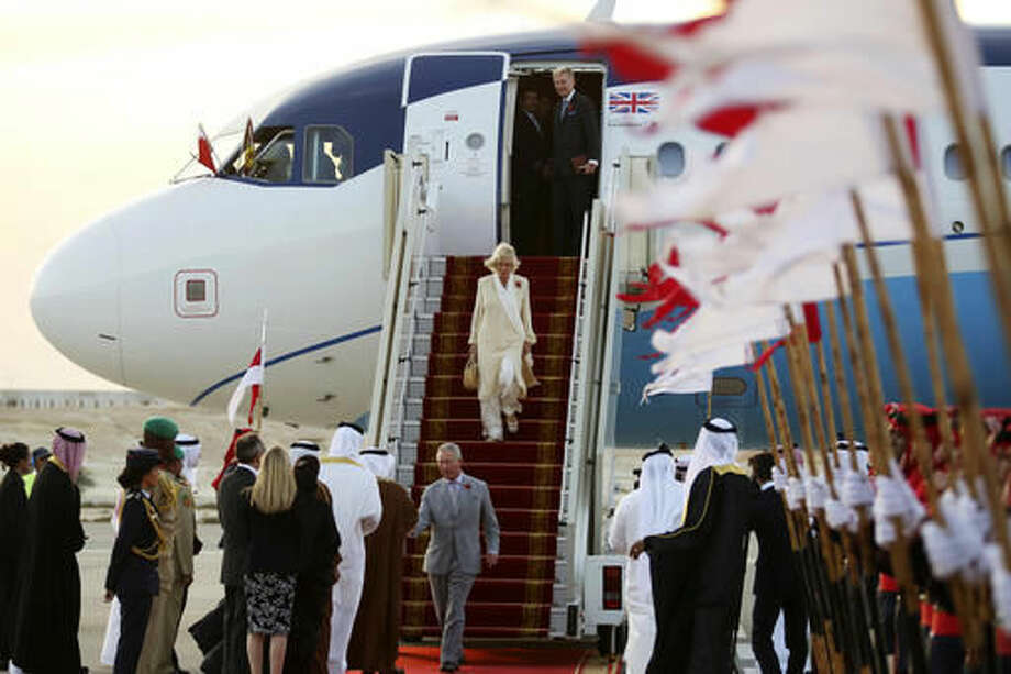 Britain's Prince Charles and his wife Camilla arrive in Manama, Bahrain, on Tuesday, Nov. 8, 2016. The royal couple are on a three-nation tour of the Gulf. (AP Photo/Jon Gambrell)