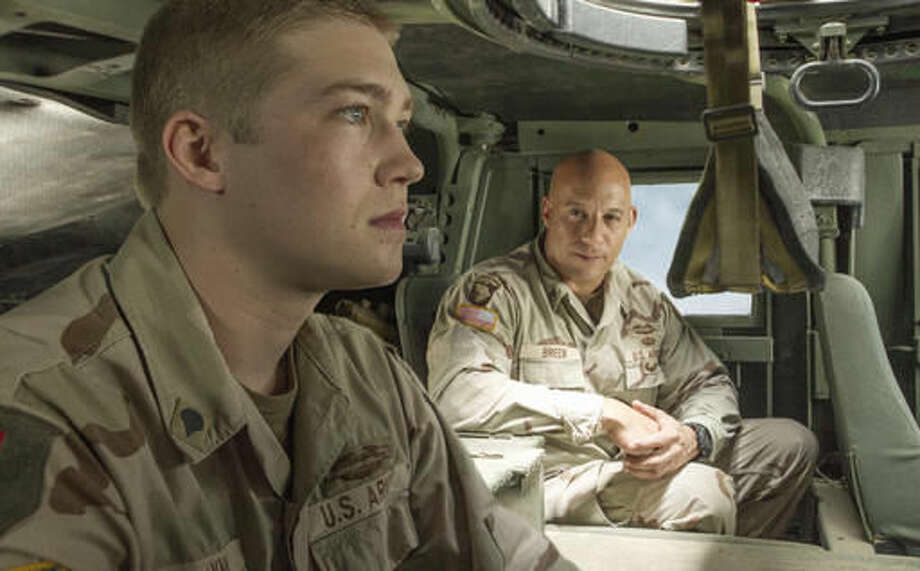 "This image released by Sony Pictures shows Joe Alwyn, left, and Vin Diesel in a scene from the film, ""Billy Lynn's Long Halftime Walk,"" in theaters on November 11. (Mary Cybulski/Sony-TriStar Pictures via AP)"