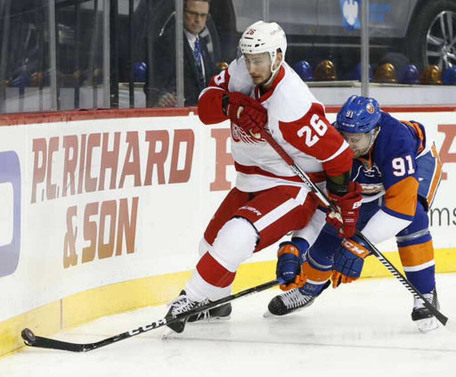 New York Islanders' center John Tavares (91) defends against Detroit Red Wings' right wing Tomas Jurco (26), of Slovakia, during the first period of an NHL hockey game, Sunday, Dec. 4, 2016, in New York. (AP Photo/Kathy Willens)