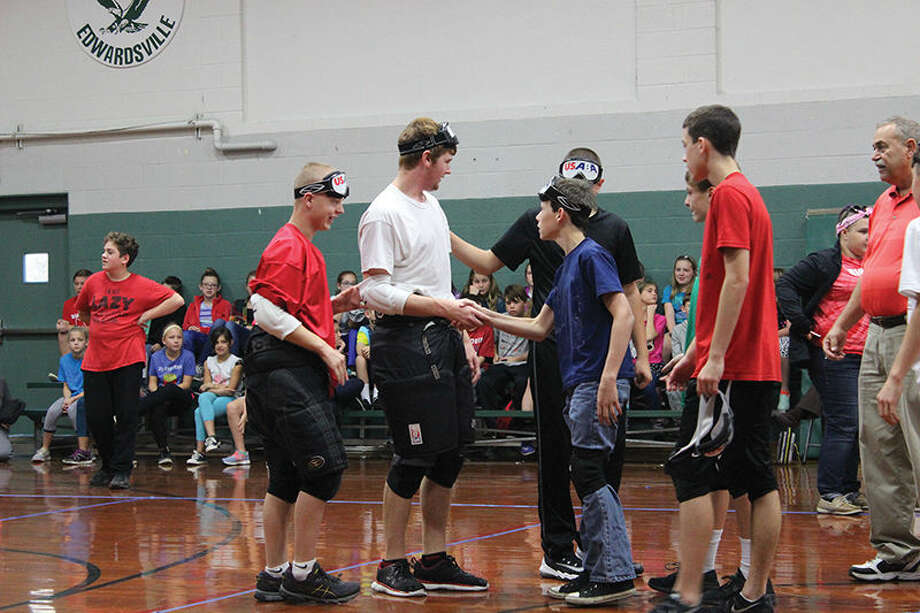 Students from the Kentucky School for the Blind and Trinity Lutheran School shake hands after a match of goalball, a paraolympic sport that utilizes hearing and movement.