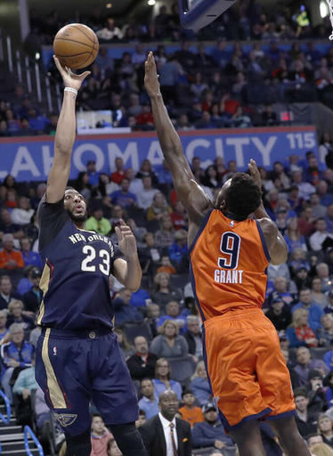 New Orleans Pelicans forward Anthony Davis (23) shoots as Oklahoma City Thunder forward Jerami Grant (9) defends during the first half of an NBA basketball game in Oklahoma City, Sunday, Dec. 4, 2016. (AP Photo/Alonzo Adams)
