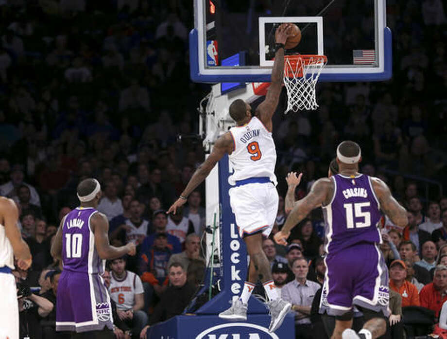 New York Knicks' Kyle O'Quinn dunks the ball during the first half of the NBA basketball game against the Sacramento Kings, Sunday, Dec. 4, 2016 in New York. (AP Photo/Seth Wenig)