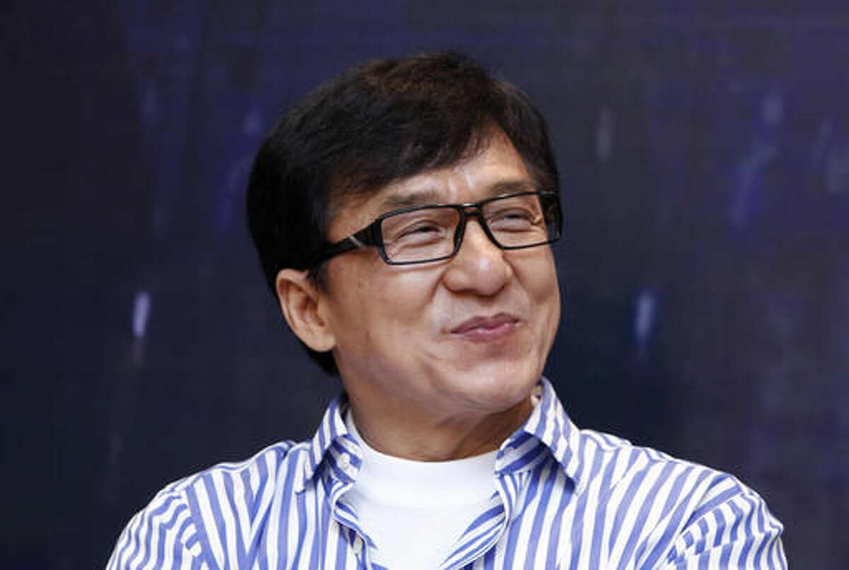 """FILE - In this Dec. 18, 2013, file photo, Hong Kong actor Jackie Chan smiles during a news conference to promote his new film """"Police Story 2013,"""" in Kuala Lumpur, Malaysia. On Saturday, Nov. 12, 2016, Chan will accept an honorary Academy Award from the film academy's Board of Governors. (AP Photo/Lai Seng Sin, File)"""
