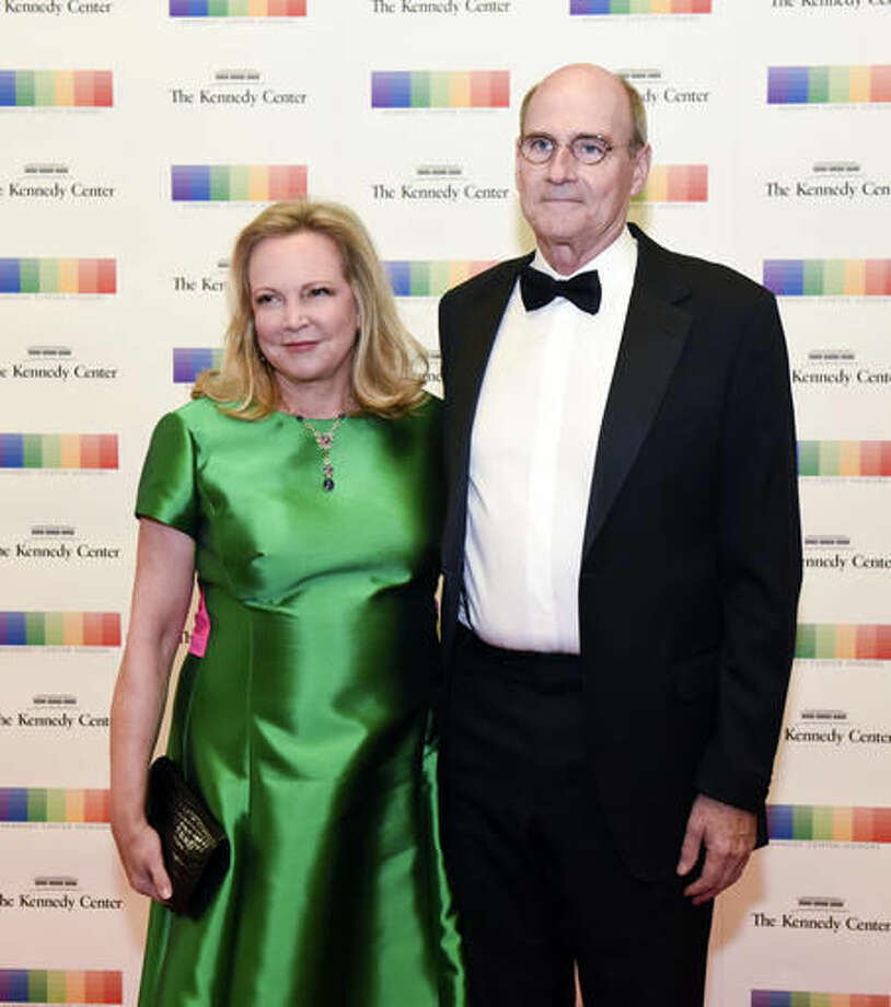 Kennedy Center Honoree James Taylor and his wife, Caroline Kim Taylor arrive at the State Department for the Kennedy Center Honors gala dinner on Saturday, Dec. 3, 2016 in Washington. (AP Photo/Kevin Wolf)