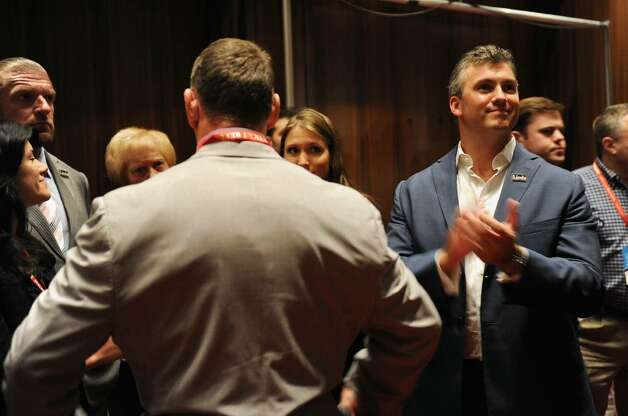 Shane McMahon claps as he hears the returns for the nomination for US Senate, during the GOP convention in downtown Hartford, Conn. on Friday May 21, 2010. His mom Linda McMahon was chosen as the nominee for the race. At left is Linda's husband Vince. Photo: Christian Abraham / Connecticut Post
