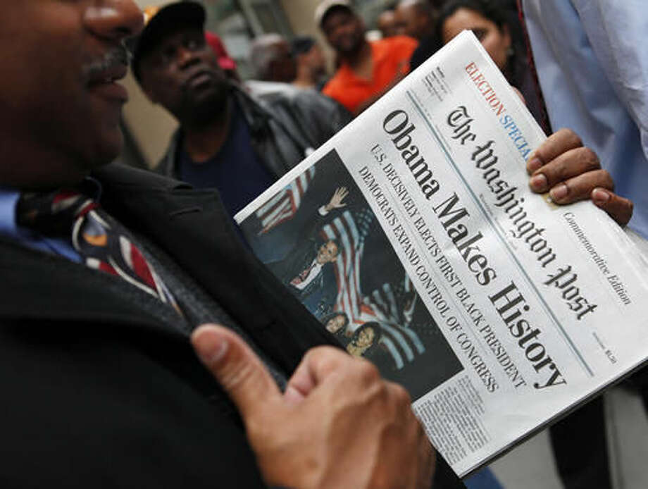 FILE - In this Nov. 5, 2008, file photo, people line up outside of the Washington Post newspaper to purchase special election editions in Washington. Newspapers are printing extra copies and setting up temporary retail stands after recalling the frenzy for an ink-stained memento after Barack Obama's historic win in 2008. Many people now rely on Facebook and apps for news, but a screenshot doesn't have quite the same romance as a newspaper's front page. (AP Photo/Haraz N. Ghanbari, File) Photo: Haraz N. Ghanbari