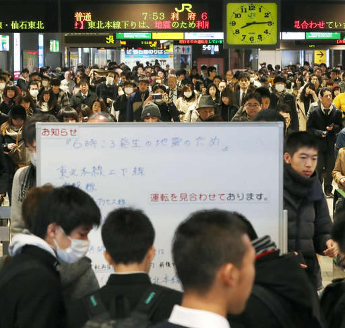 Passengers crowd around the information board posting full suspension of the Tohoku Main Line train service due to an earthquake at Sendai Station in Sendai, Miyagi prefecture, northern Japan, Tuesday, Nov. 22, 2016. Coastal residents in Japan were ordered to flee to higher ground on Tuesday after a strong earthquake struck off the coast of Fukushima prefecture. (Jun Hirata/Kyodo News via AP)