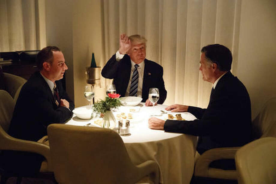 President-elect Donald Trump, center, eats dinner with Mitt Romney, right, and Trump Chief of Staff Reince Priebus at Jean-Georges restaurant, Tuesday, Nov. 29, 2016, in New York. (AP Photo/Evan Vucci) Photo: Evan Vucci