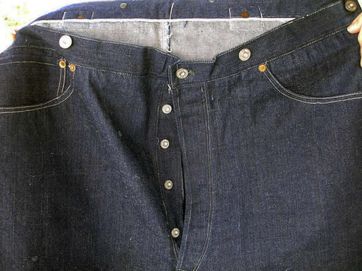 This undated photo provided by Daniel Buck Auctions & Appraisals shows the front of a pair of 1893 Levi-Strauss denim blue jeans in pristine condition that will go up for auction Saturday, Nov. 5, 2016 in Lisbon Falls, Maine. The auction house said the jeans were ordered for Solomon Warner, a businessman and pioneer who participated in the creation of the Arizona Territory. Warner wore them only a few times before falling ill. He died in 1899. (Daniel Buck Soules/Daniel Buck Auctions & Appraisals via AP)