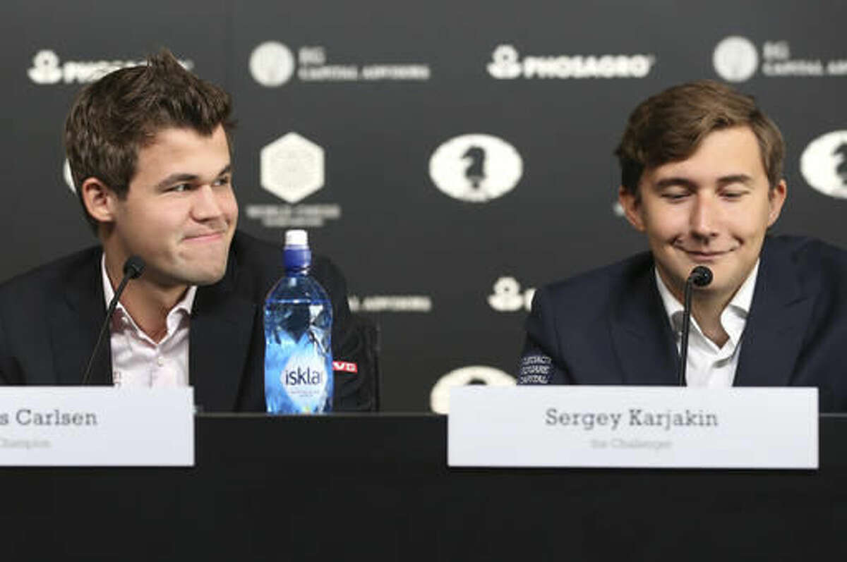 Chess world champion Magnus Carlsen, of Norway, left, and his challenger, Sergey Karjakin, of Russia, participate in a news conference for promote the World Chess Championship in New York, Thursday, Nov. 10, 2016. The championship returns to New York after 21 years and runs until Nov. 30, 2016. (AP Photo/Seth Wenig)