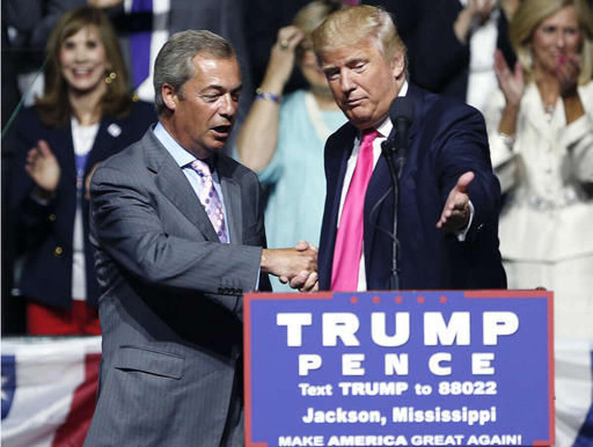 """FILE - In this Wednesday, Aug. 24, 2016, file photo, then-Republican presidential candidate Donald Trump, right, welcomes pro-Brexit British politician Nigel Farage, to speak at a campaign rally in Jackson, Miss. Nigel Farage, the interim leader of the U.K. Independence Party, says he is """"flattered"""" by Donald Trump's suggestion that he become Britain's ambassador to the United States. Farage said Tuesday he would do anything possible to help relations between the two countries even as Prime Minister Theresa May's office said Britain already has an ambassador in place in Washington. (AP Photo/Gerald Herbert, File)"""