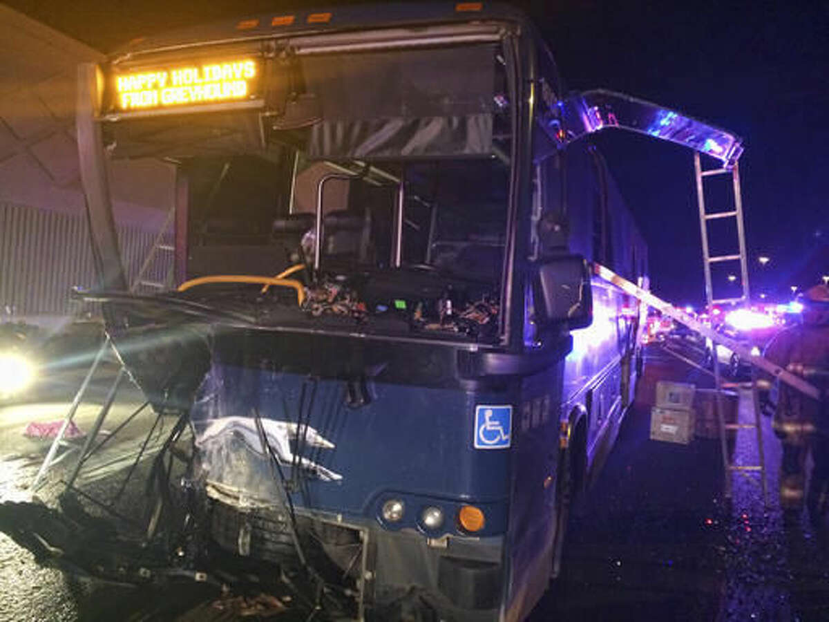 This photo provided by the Arizona Department of Public Safety shows the remains of a Greyhound Bus after it was hit head-on by a car being driven the wrong way on Interstate 10 in a Phoenix suburb, Friday Nov. 25, 2016. The Arizona Department of Public Safety says the westbound car's driver was killed at the scene and that multiple passengers on the eastbound bus were taken to hospitals for treatment of injuries described as non-life threatening. (Arizona Department of Public Safety via AP)
