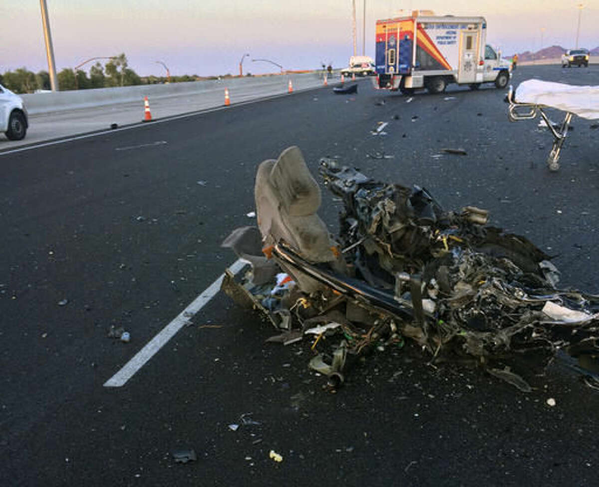 This photo provided by the Arizona Department of Public Safety shows debris from a car that hit a Greyhound bus head-on on Interstate 10 in a Phoenix suburb, Friday, Nov. 25, 2016. The Arizona Department of Public Safety says the westbound car's driver was killed at the scene and that multiple passengers on the eastbound bus were taken to hospitals for treatment of injuries described as non-life threatening. (Arizona Department of Public Safety via AP)