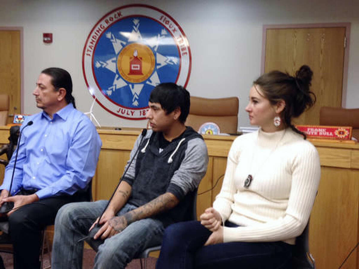 Standing Rock Sioux Chairman Dave Archambault, left, tribal youth Garrett Hairychin and actress Shailene Woodley, right, look on as several celebrities met with tribal officials and youth in Fort Yates, N.D. to discuss efforts to halt construction of the Dakota Access oil pipeline. (AP Photo/James MacPherson)