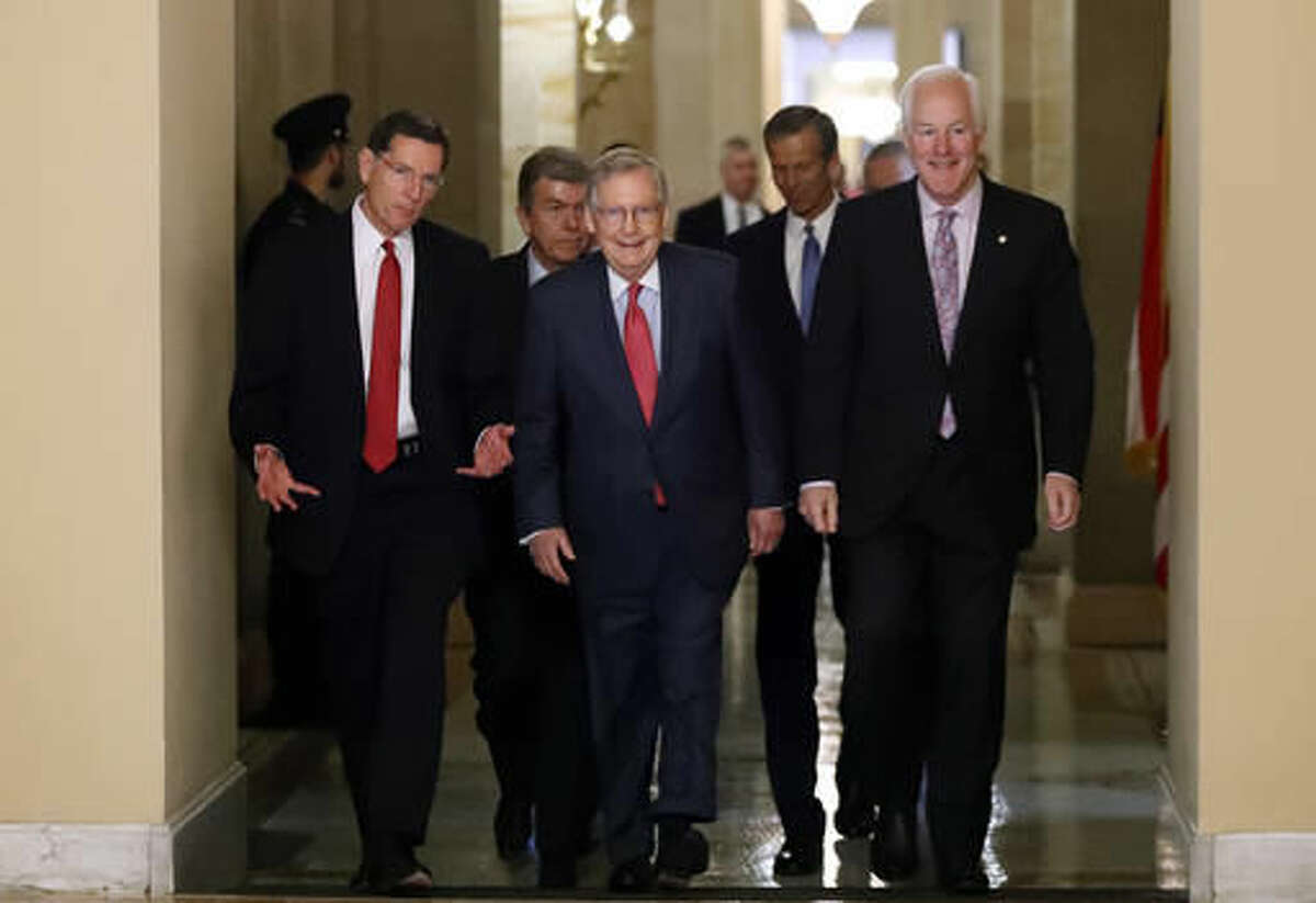 Senate Majority Leader Mitch McConnell of Ky., center, walks with Sen. John Barrasso, R-Wyo., and Senate Majority Whip John Cornyn of Texas on Capitol Hill in Washington, Wednesday, Nov. 16, 2016, after a caucus organizing meeting to elect their leadership for the upcoming 115th Congress. (AP Photo/Alex Brandon)