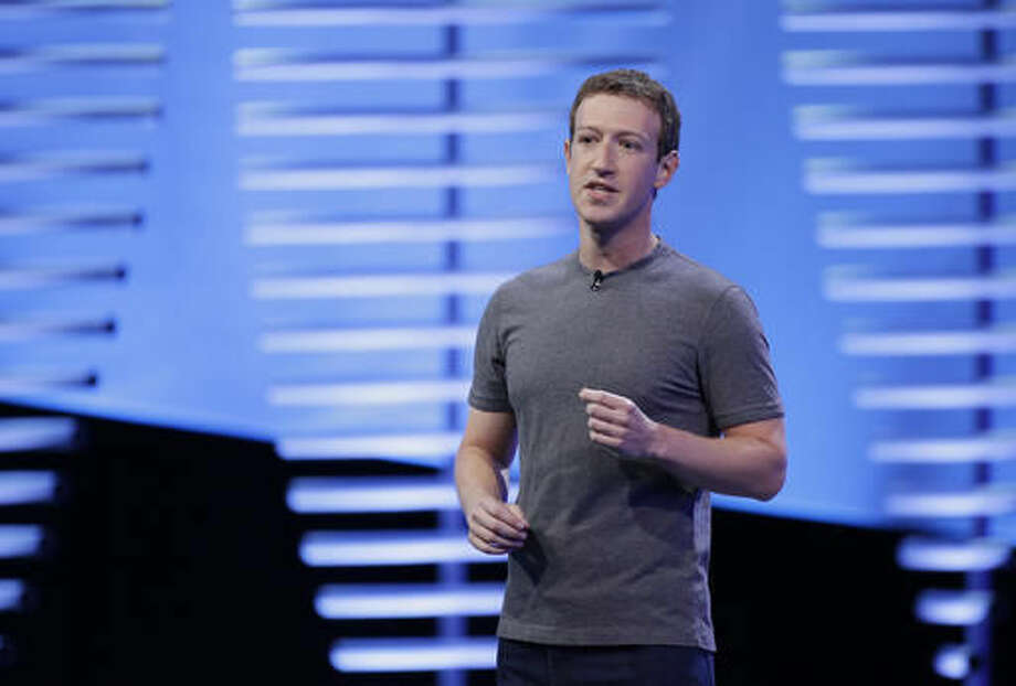 """FILE- In this April 12, 2016, file photo, Facebook CEO Mark Zuckerberg speaks during the keynote address at the F8 Facebook Developer Conference in San Francisco. CEOs of major companies are taking stands about the results of the November 2016 U.S. election, a departure from the traditional model of not mixing politics with business that the major brands have long espoused. Zuckerberg said """"progress does not move in a straight line."""" (AP Photo/Eric Risberg, File) Photo: Eric Risberg"""
