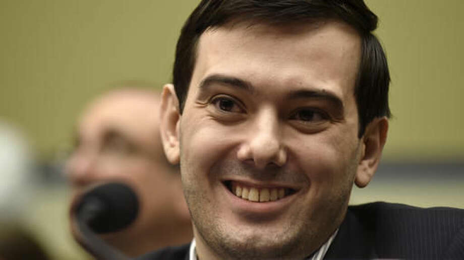 FILE - In this Feb. 4, 2016 file photo, Pharmaceutical chief Martin Shkreli smiles on Capitol Hill in Washington during the House Committee on Oversight and Reform Committee hearing on his former company's decision to raise the price of a lifesaving medicine. President-elect Donald Trump's victory prompted Martin Shkreli on Wednesday, November 9, 2016, to publicly debut some songs off the one-of-a-kind Wu-Tang Clan album he bought for $2 million last year. (AP Photo/Susan Walsh, File) Photo: Susan Walsh