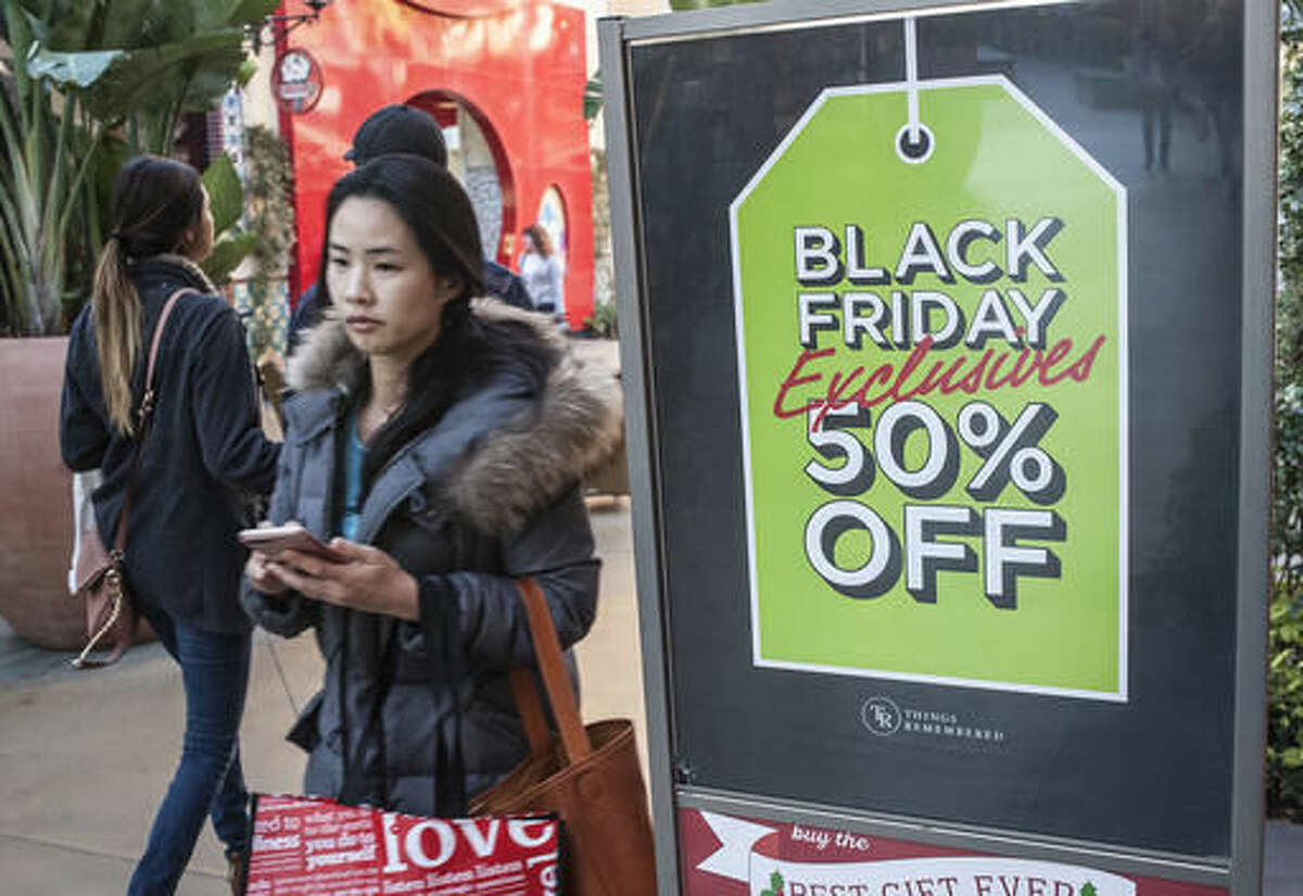Shoppers look for deals at the Irvine Spectrum Center in Irvine, Calif., on Black Friday, Nov. 25, 2016. Stores are trying to better cater to savvier shoppers, who are splitting their spending back and forth online and in stores. That was apparent on Black Friday, the day after Thanksgiving, as shoppers were careful about what deals they'd jump at and retailers pushed different ways to connect with customers. (Nick Agro/The Orange County Register via AP)
