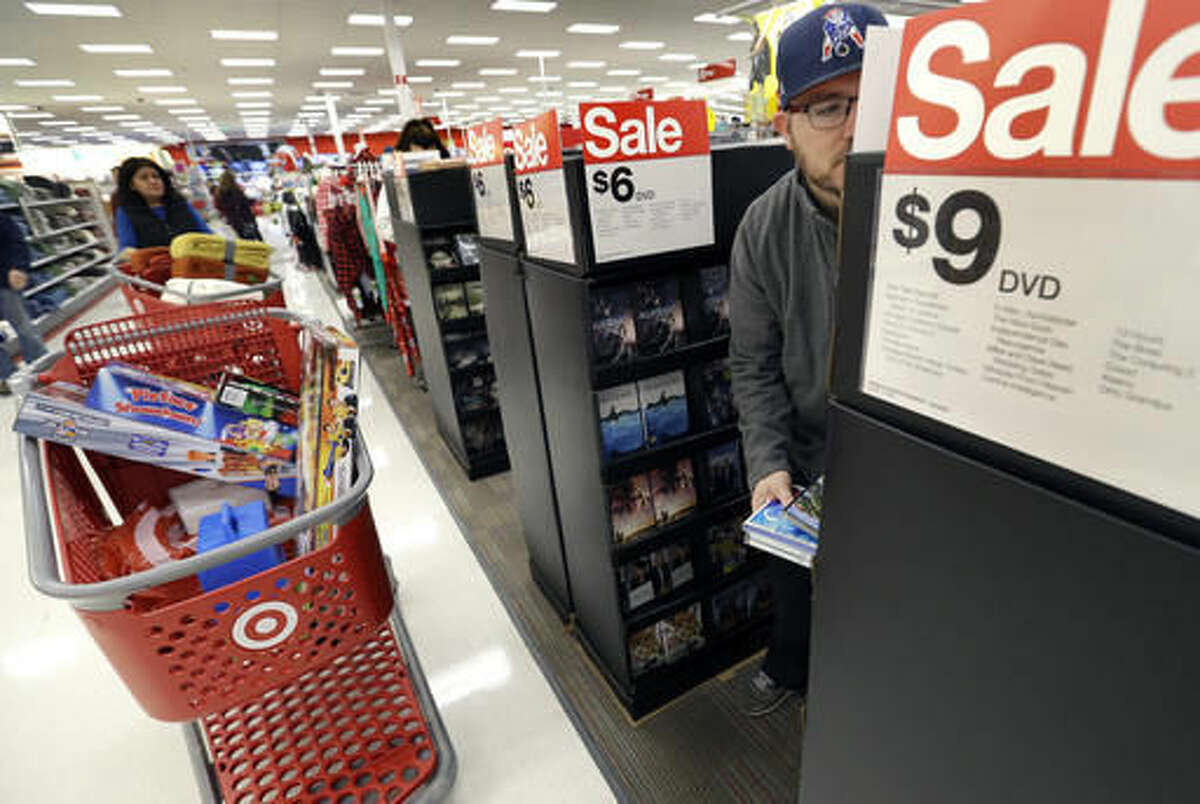 Paul Poirier shops for sales at Target on Black Friday, Nov. 25, 2016, in Wilmington, Mass. Stores open their doors Friday for what is still one of the busiest days of the year, even as the start of the holiday season edges ever earlier. (AP Photo/Elise Amendola)