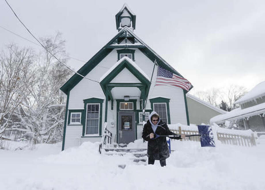 Postal clerk Pamela Bentley shovels lake-effect snow in front of the U.S. Post Office, Monday, Nov. 21, 2016, in Grafton, N.Y. (AP Photo/Mike Groll) Photo: Mike Groll