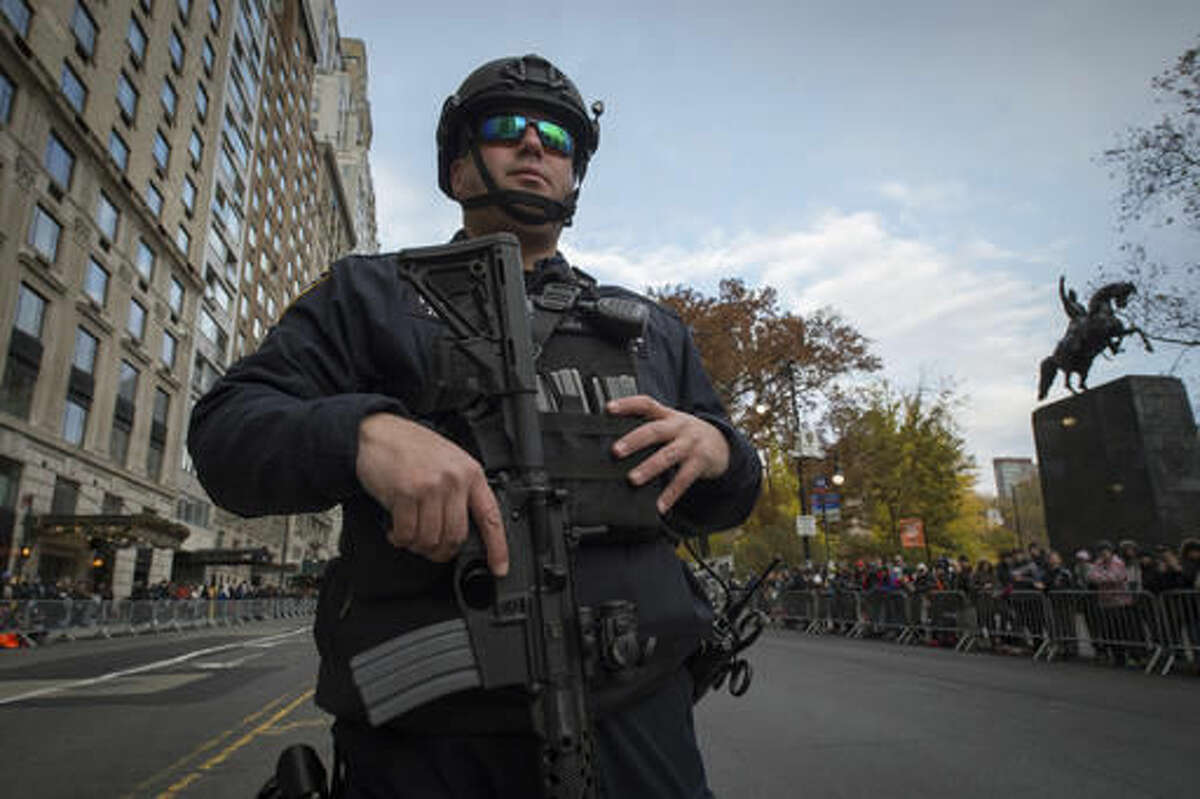 A heavily armed member of the NYPD stands on Central Park South before the Macy's Thanksgiving Day Parade, Thursday, Nov. 24, 2016, in New York. (AP Photo/Bryan R. Smith)