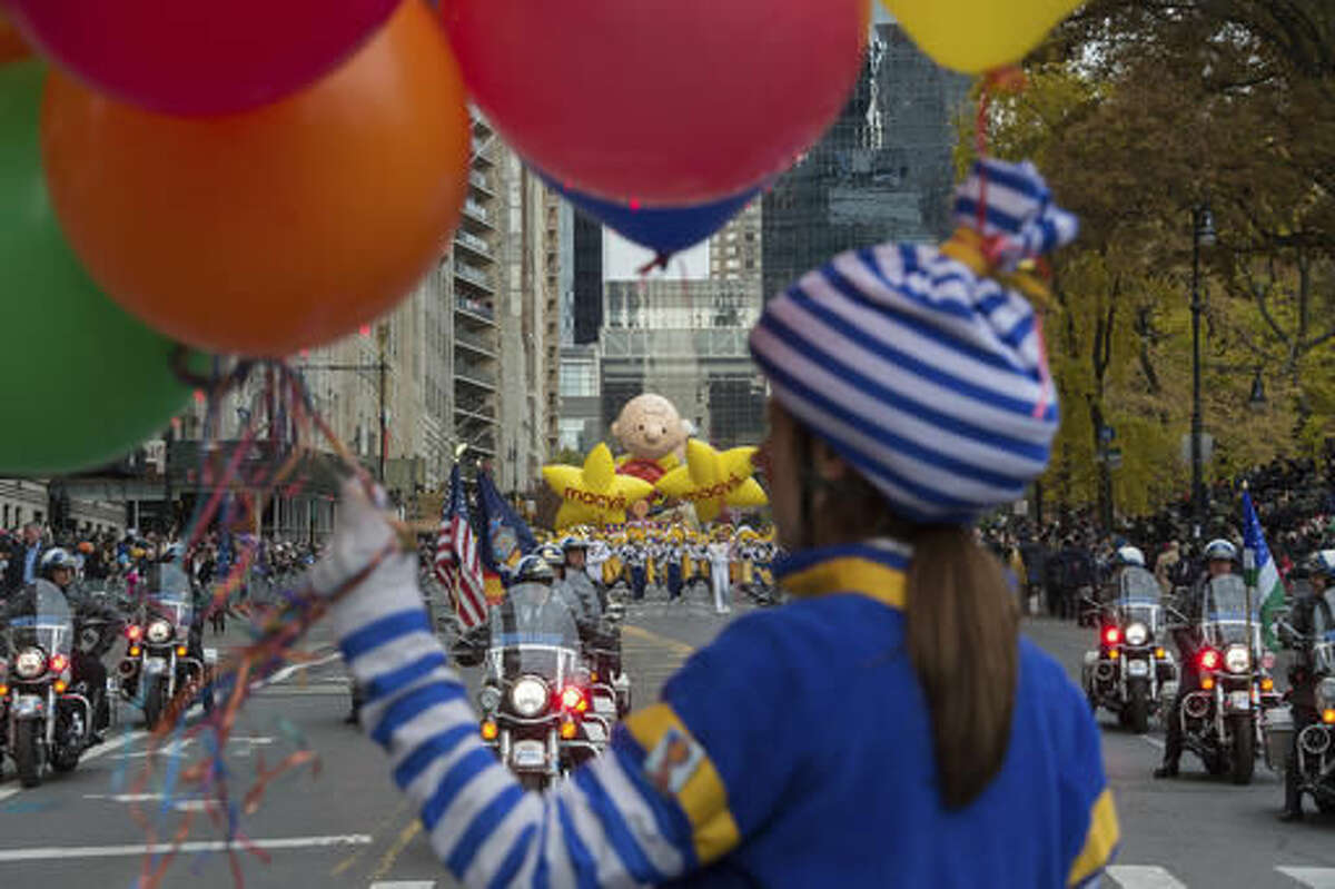 A character with balloons marches in the Macy's Thanksgiving Day Parade, Thursday, Nov. 24, 2016, in New York. (AP Photo/Bryan R. Smith)