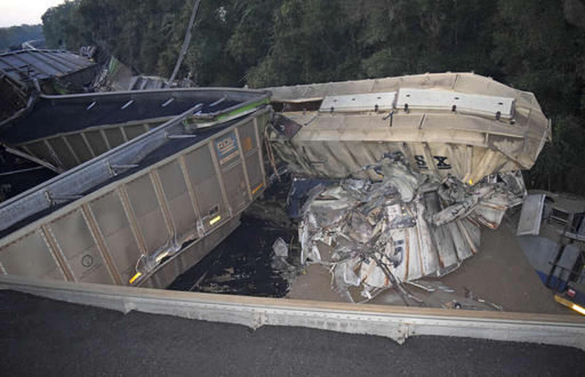 This Wednesday, Nov. 16, 2016 photo provided by Marion County Fire Rescue shows derailed CSX train cars in Citra, Fla. Authorities say two trains loaded with coal and phosphate rock collided in central Florida, derailing and sending at least 20 train cars tumbling over. CSX Corp. owns both trains. The company said in a news release that a fuel spill has been reported at the site, and they are sending environmental experts to the scene to aid in containment of hazardous materials at the site, CSX said in a news release. (James Lucas/Marion County Fire Rescue via AP)