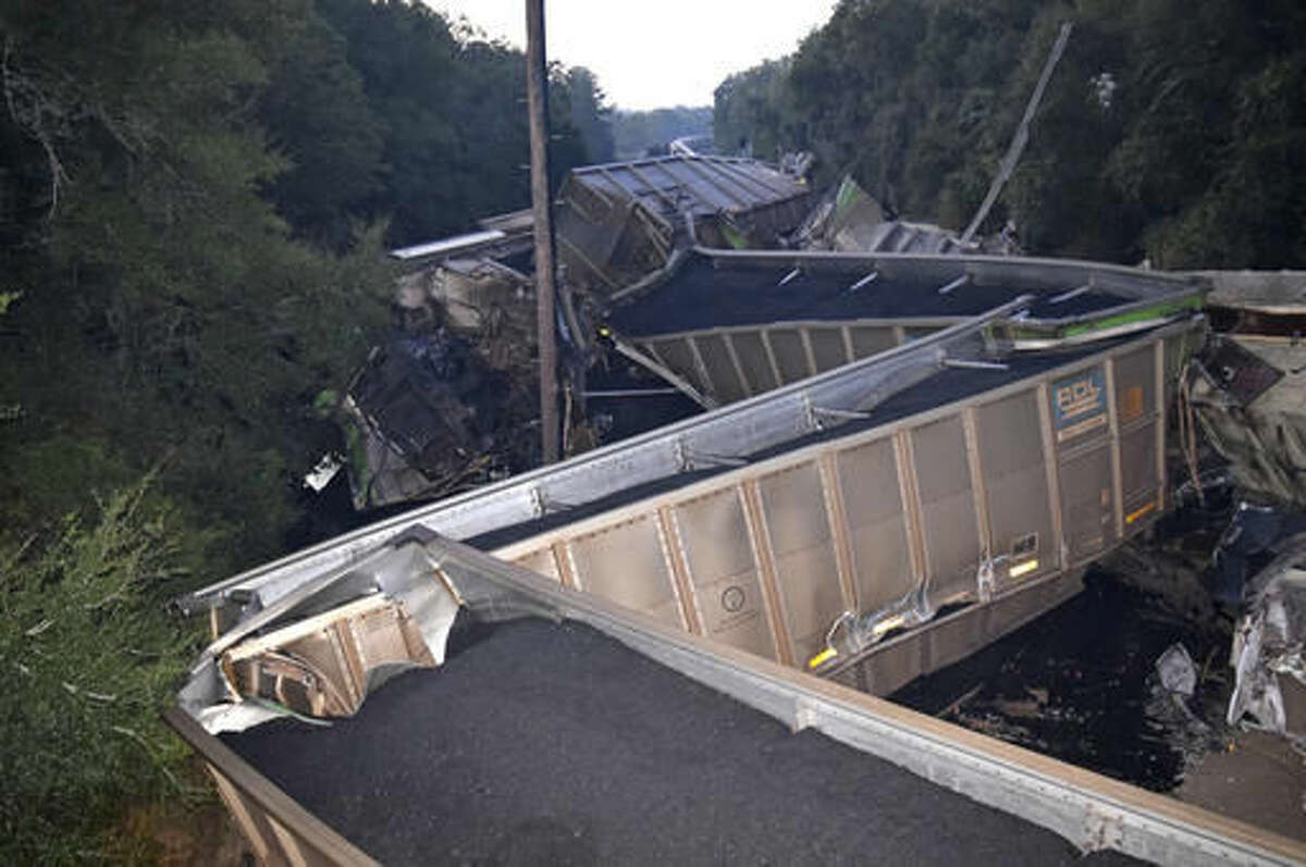 This Wednesday, Nov. 16, 2016 photo provided by Marion County Fire Rescue shows derailed CSX train cars in Citra, Fla. Authorities say two trains loaded with coal and phosphate rock collided in central Florida, derailing and sending at least 20 train cars tumbling over. CSX Corp. owns both trains. The company said in a news release that a fuel spill has been reported at the site. The company was sending environmental experts to the scene to aid in containment of hazardous materials at the site, CSX said in a news release. (James Lucas/Marion County Fire Rescue via AP)
