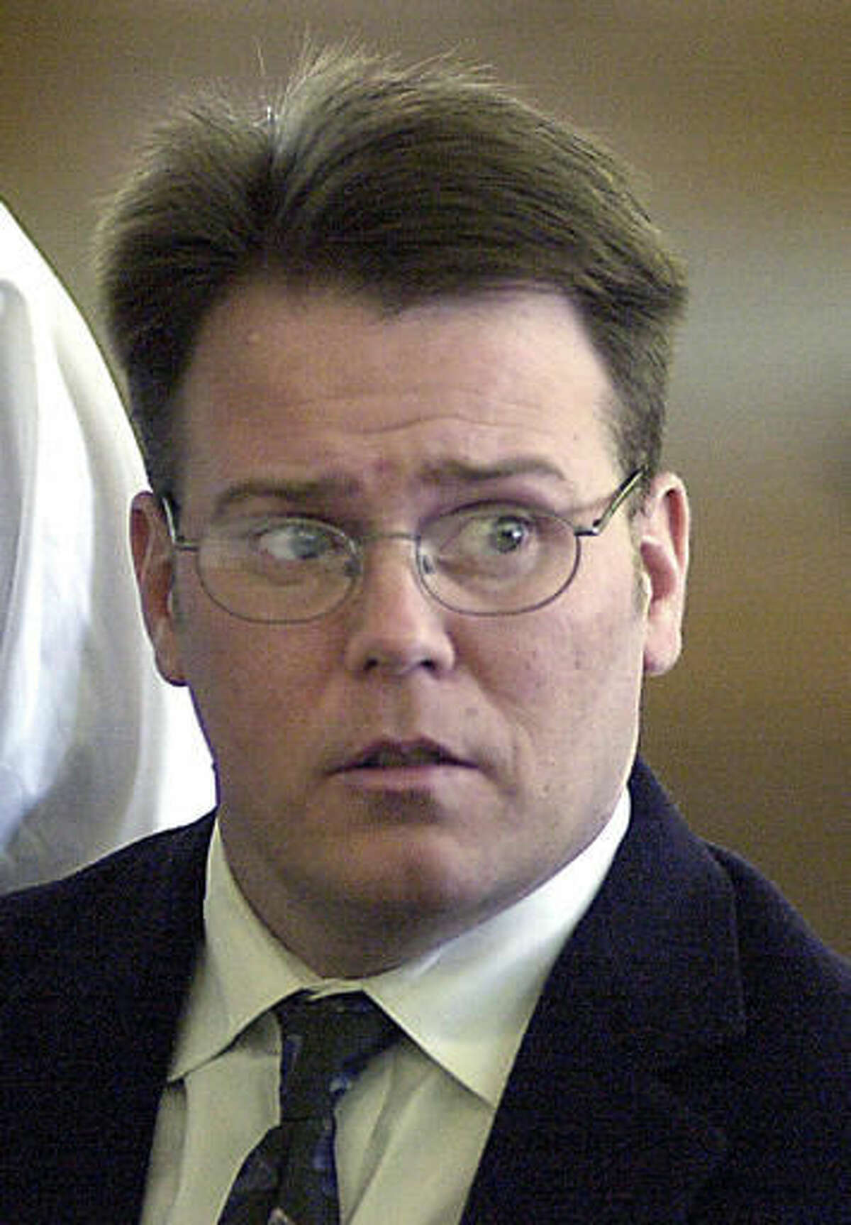 In this May, 7, 2001 photo, Daniel Holland sits at the defendants table at the start of his trial for murder in Norfolk Superior Court, in Dedham, Mass. Holland was convicted and imprisoned for the homicide of his wife Elizabeth. The couple's 8-year-old son found his mother's body and years later won a groundbreaking legal battle to terminate his father's parental rights. Holland is appealing a judge's refusal to grant him a new trial. (Greg Derr/The Quincy Patriot Ledger via AP)
