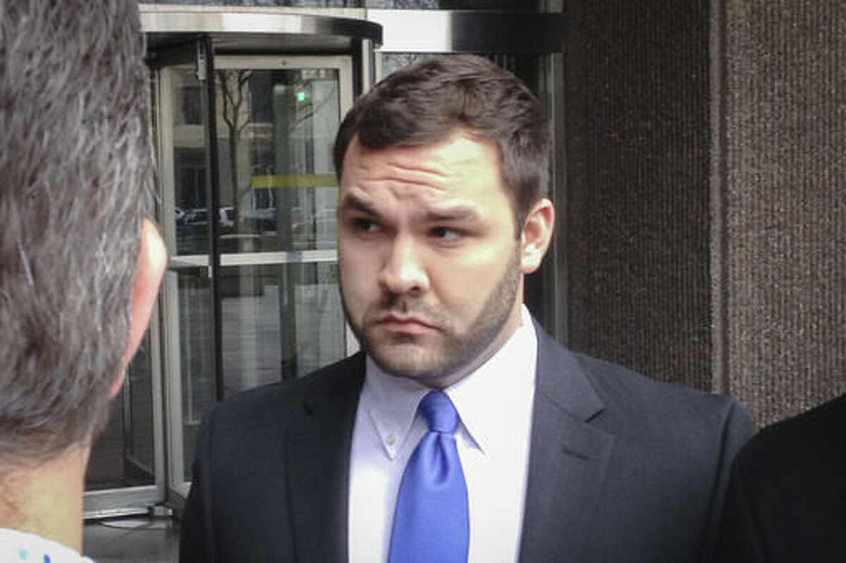 FILE - In this March 25, 2016, file photo, Thomas DiMassimo, listens as his lawyer speaks outside federal court after a hearing in Dayton, Ohio. With the election over, a federal judge has ended probation for an Ohio man who tried to rush a Donald Trump rally stage. Judge Sharon Ovington's Thursday, Nov. 17, order says she cut short a scheduled, one-year probation for DiMassimo based on his probation officer's recommendation and without objection from the U.S. attorney's office. (Steve Mehaffie/Dayton Daily News via AP, File)