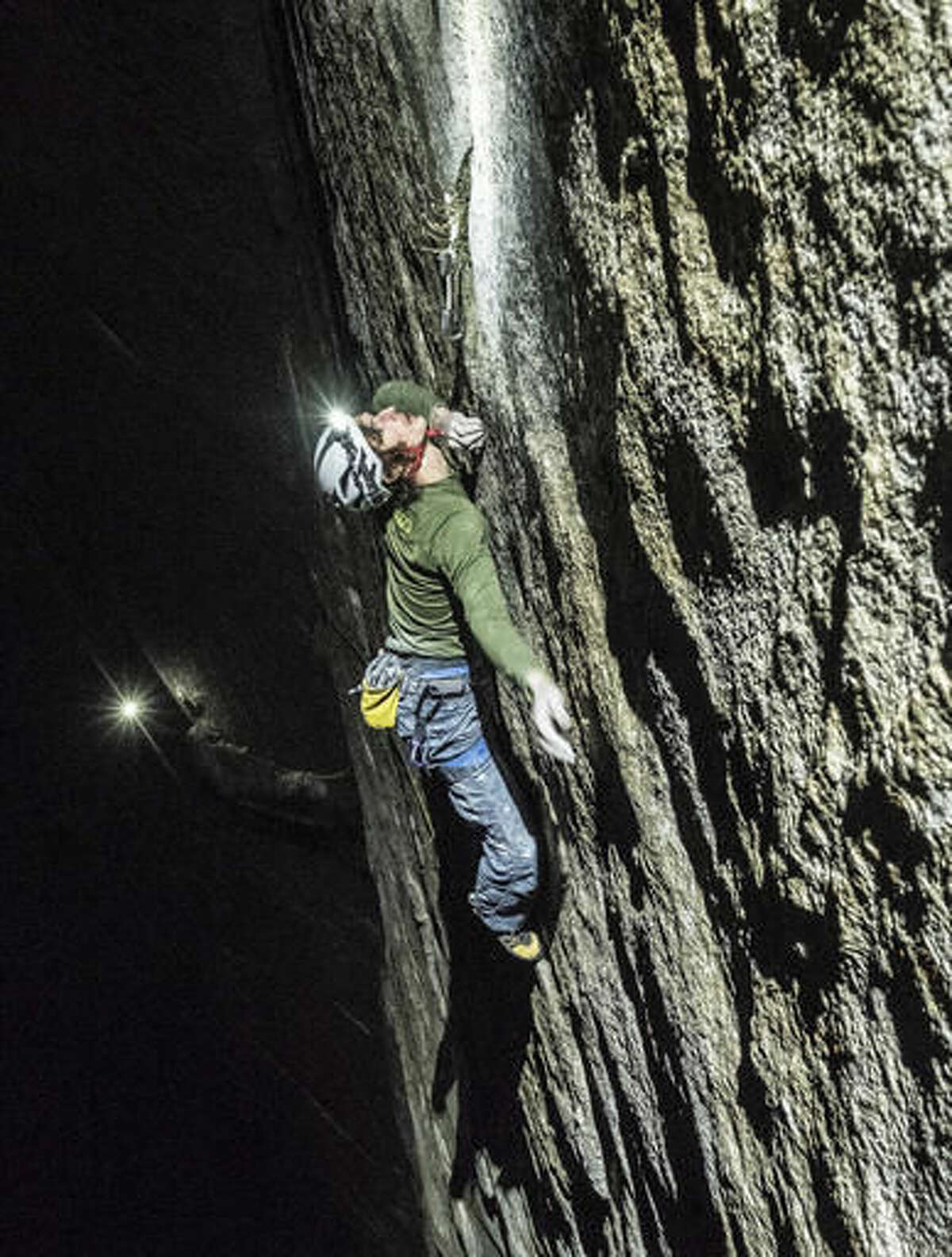 In this November 2016 photo courtesy of Heinz Zak and Black Diamond Equipment, Adam Ondra climbs pitch 21 by headlamp on the Dawn Wall of El Capitan in Yosemite National Park, Calif. A climber from the Czech Republic has scaled what's considered one of the world's most challenging rock walls found in Yosemite National Park, doing it in record time. A spokesman for Black Diamond Equipment confirmed Tuesday, Nov. 22, 2016, that 23-year-old Adam Ondra completed a half-mile free-climb up the Dawn Wall on the famous El Capitan. (Heinz Zak/Courtesy of Black Diamond Equipment via AP)