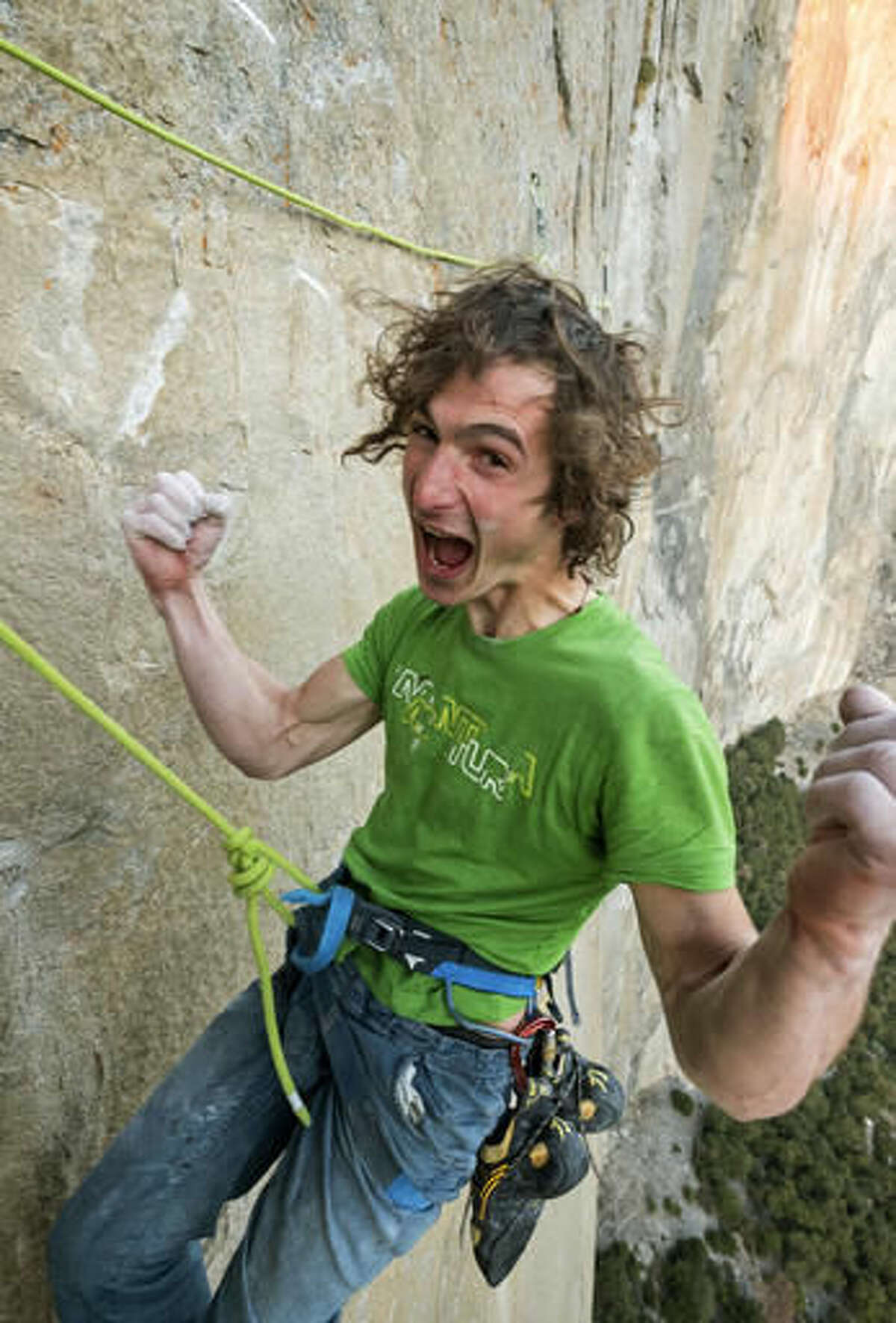 In this November 2016 photo courtesy of Heinz Zak and Black Diamond Equipment, Adam Ondra celebrates after finishing the most difficult pitches of his climb on the Dawn Wall of El Capitan in Yosemite National Park, Calif. Ondra, from the Czech Republic, scaled what's considered one of the world's most challenging rock walls found in Yosemite National Park, and he did it in record time. A spokesman for Black Diamond Equipment confirmed Tuesday, Nov. 22, 2016, that 23-year-old Adam Ondra completed a half-mile free-climb up the Dawn Wall on the famous El Capitan. (Heinz Zak/Courtesy of Black Diamond Equipment via AP)