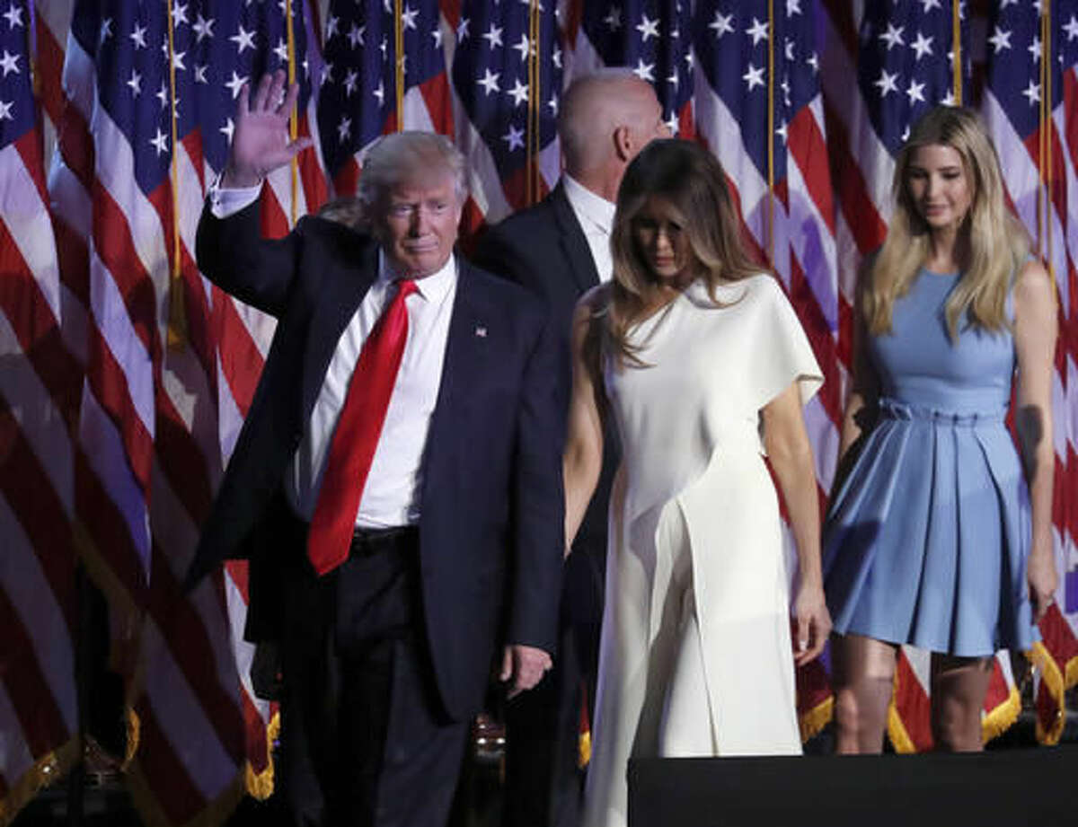 President-elect Donald Trump waves as he walks with his wife Melania Trump followed by his daughter Ivanka Trump after giving his acceptance speech during his election night rally, Wednesday, Nov. 9, 2016, in New York. (AP Photo/Mary Altaffer)