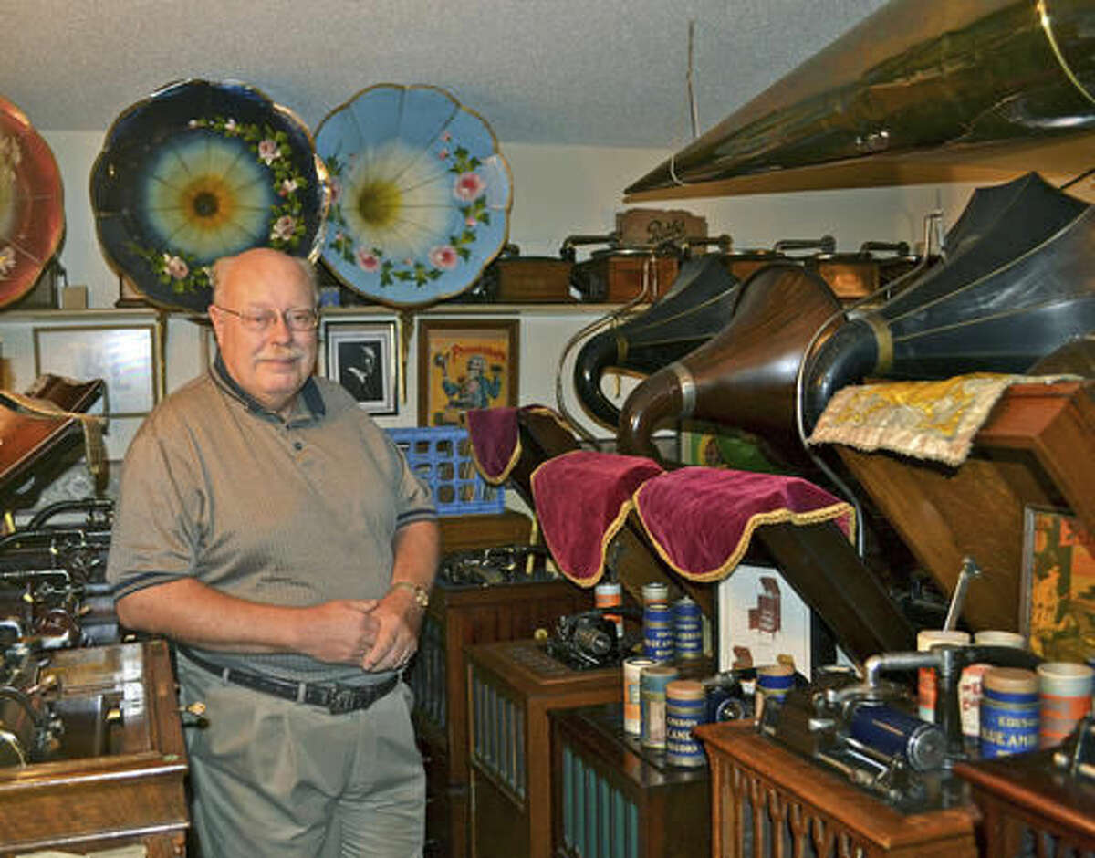 ADVANCE FOR USE SUNDAY, NOV. 13 AND THEREAFTER - In this Oct. 5, 2016 photo, Burdette Walters, of Wellsburg, Iowa, a life-long collector of phonographs, poses at home with part of his collection. He owns over 175 phonographs of varying age, size and brand. (Sara Jordan-Heintz/The Times-Republican via AP)