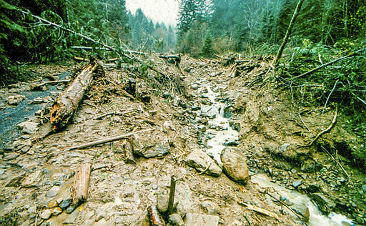 This November, 1996, photo shows the Hubbard Creek landslide near Umpqua, Ore. Twenty years ago, heavy rain started falling in mid-November in Oregon's Douglas County, and it seemed like it would never end. The ground became so saturated that it caused floods, landslides, fallen trees, power outages and road washouts including a huge sinkhole on Interstate 5 in Roseburg, Ore. (The News Review via AP)
