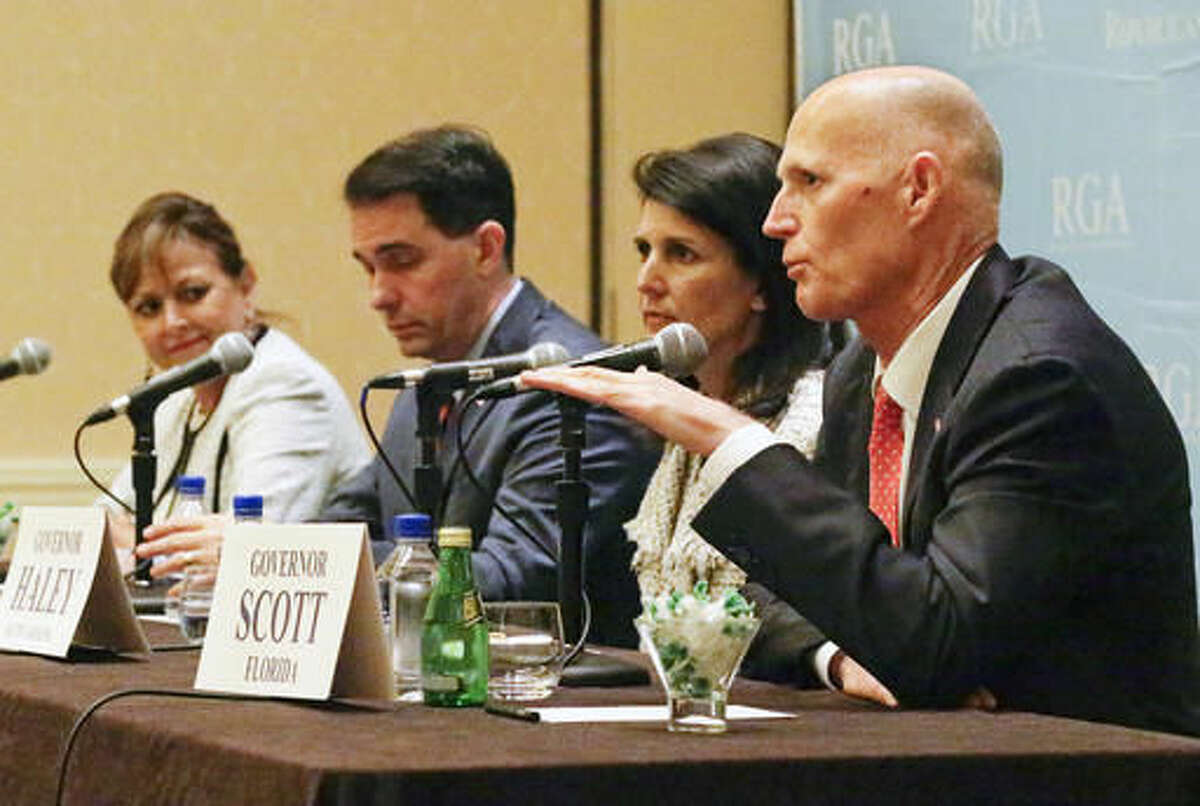 Florida Gov. Rick Scott, front right, speaks during a news conference as from left, New Mexico's Gov. Susana Martinez, Wisconsin's Gov. Scott Walker and South Carolina's Gov. Nikki Haley listen, at the Republican Governors Association annual conference, Tuesday, Nov. 15, 2016, in Orlando, Fla. (AP Photo/John Raoux)