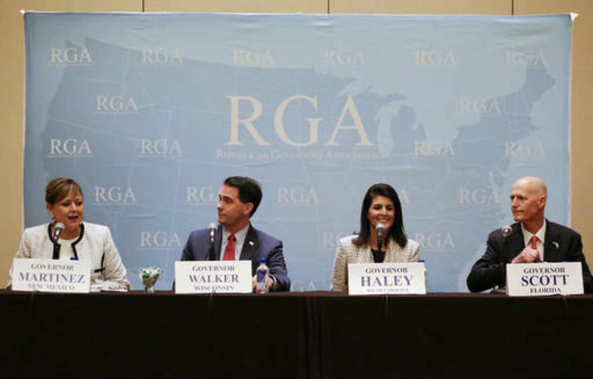 New Mexico Gov. Susana Martinez, left, speaks during a news conference with Wisconsin Gov. Scott Walker, South Carolina Gov. Nikki Haley and Florida Gov. Rick Scott at the Republican Governors Association annual conference, Tuesday, Nov. 15, 2016, in Orlando, Fla. (AP Photo/John Raoux)
