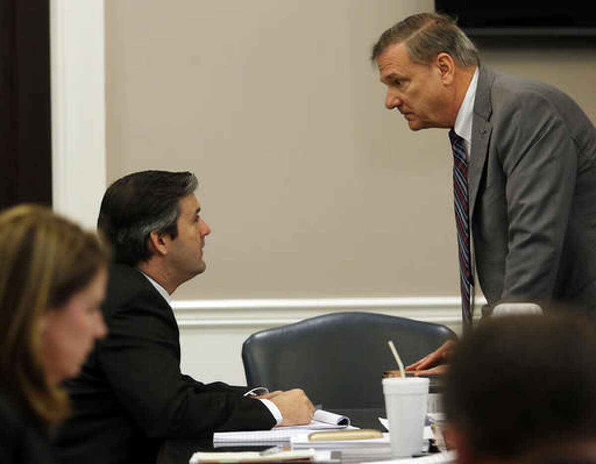 Former North Charleston police officer Michael Slager speaks to a member of the defense team during his trial at the Charleston County court in Charleston, S.C., Monday, Nov. 21, 2016. Slager is charged in the April 2015 shooting death of 50-year-old Walter Scott as Scott fled from a traffic stop.(Grace Beahm/Post and Courier via AP, Pool)
