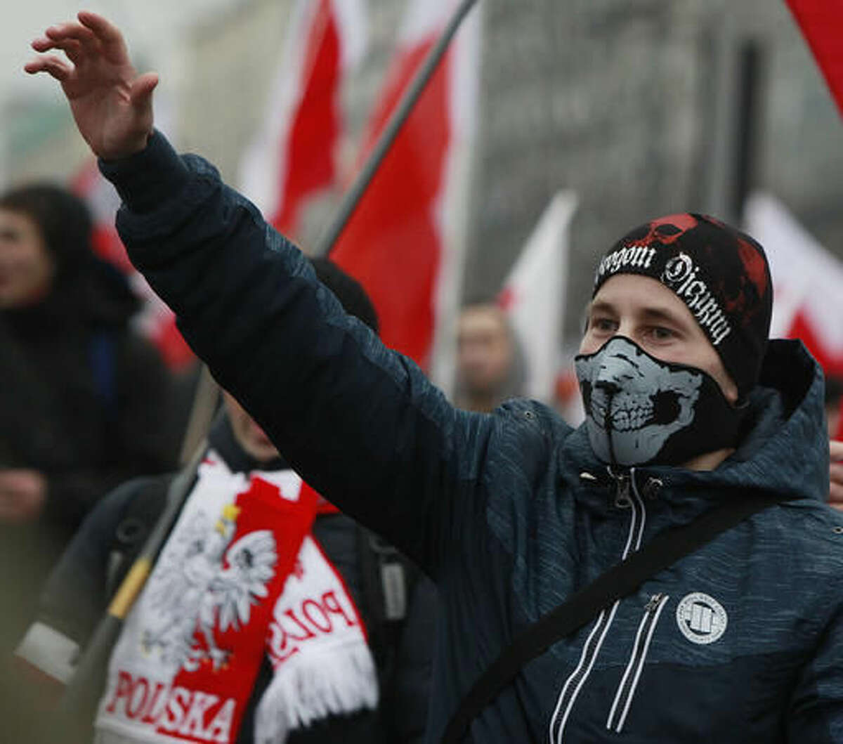 Nationalists, carrying Polish flags, as they march in large numbers through the streets of Warsaw to mark Poland's Independence Day in Warsaw, Poland, Friday, Nov. 11, 2016. (AP Photo/Czarek Sokolowski)