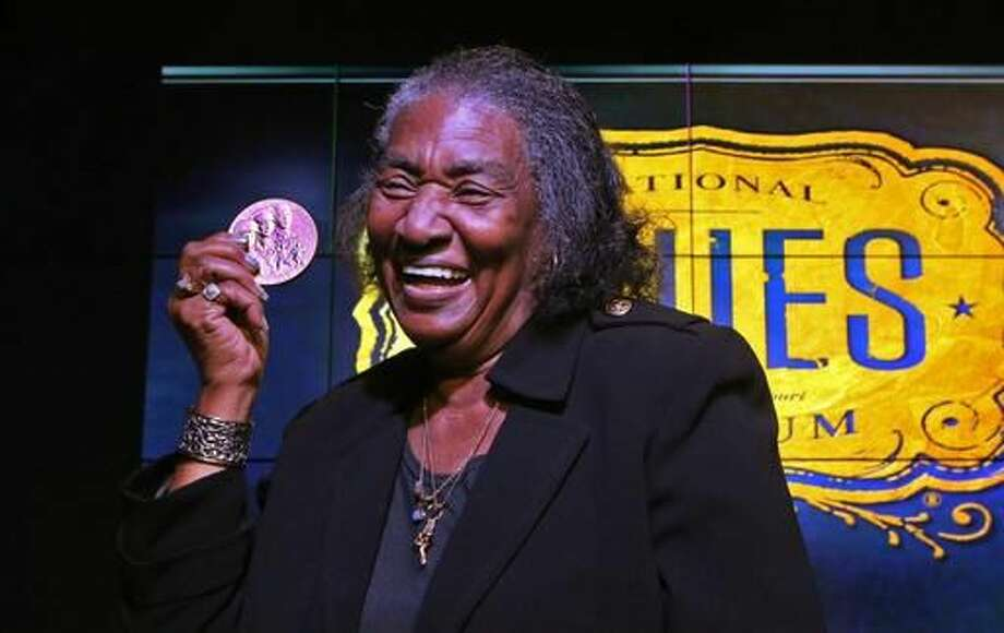 Frances Johnson, widow of jazz and blues pianist Johnnie Johnson, holds up the Congressional Gold Medal that was awarded to her late husband on Monday, Nov. 28, 2016, during a ceremony at the National Blues Museum in downtown St. Louis. Johnnie Johnson died in St. Louis in 2005. ( J.B. Forbes/St. Louis Post-Dispatch via AP) Photo: J.B. Forbes