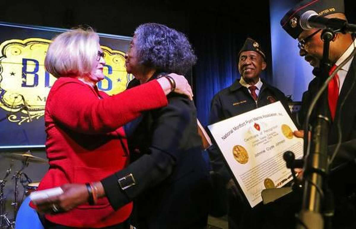 U.S. Senator Claire McCaskill, left, hugs Frances Johnson, widow of jazz and blues pianist Johnnie Johnson during a ceremony at the National Blues Museum in downtown St. Louis, , on Monday, Nov. 28, 2016. Frances Johnson received the Congressional Gold medal and a letter from President Barack Obama honoring her late husband. ( J.B. Forbes/St. Louis Post-Dispatch via AP)