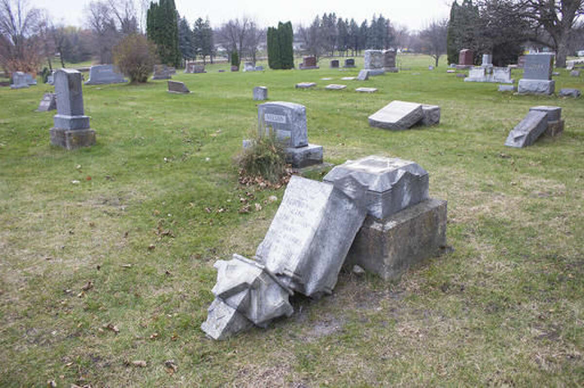 Albert Lea police are looking for unknown suspects after more than 100 gravesites were damaged at Graceland Cemetery Sunday night, Nov. 13, 2016, the third act of vandalism there this year. Damage is estimated at $14,000. (Sam Wilmes/Albert Lea Tribune via AP)