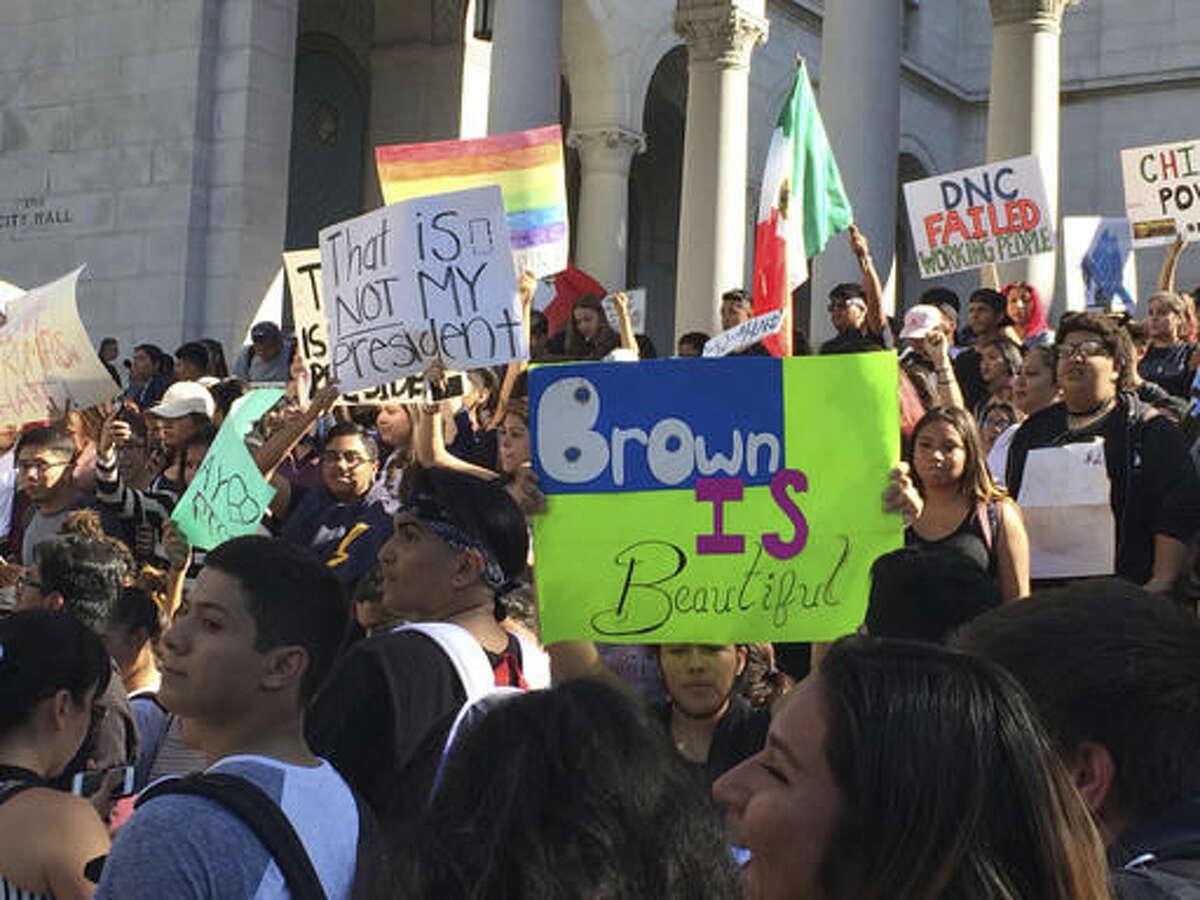 High school students protest against the election of President-elect Donald Trump on the steps of Los Angeles City Hall Monday, Nov. 14, 2016. Students from several Los Angeles schools have walked out of classes to protest the election of Donald Trump as president. (AP Photo/Reed Saxon)