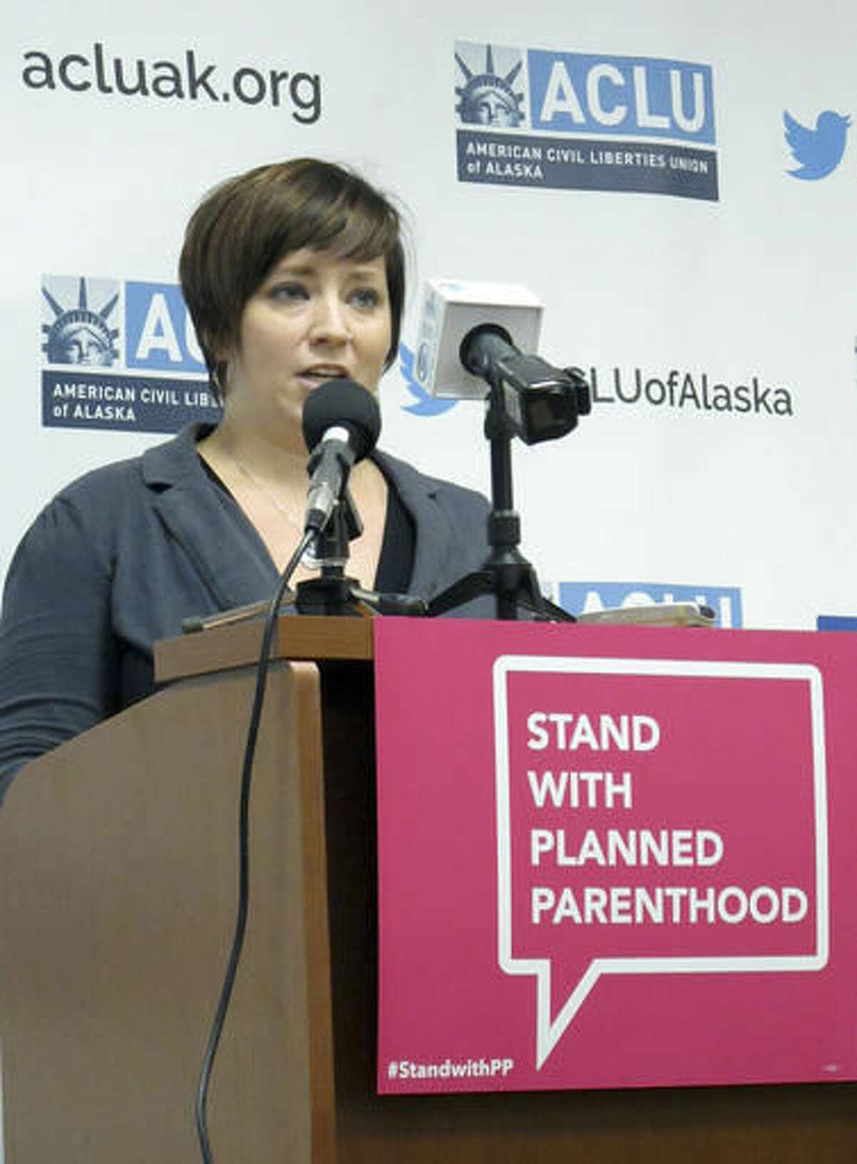 Jessica Cler, with Planned Parenthood, discusses a lawsuit filed against the state of Alaska to challenge abortion restrictions that plaintiffs say effectively prevent outpatient health facilities in the state from providing second-trimester abortions during a news conference Wednesday, Nov. 30, 2016, in Anchorage, Alaska. Planned Parenthood and its allies filed lawsuits in Alaska, North Carolina and Missouri Wednesday to challenge laws they view as unconstitutional restrictions on abortion. (AP Photo/Rachel D'Oro)