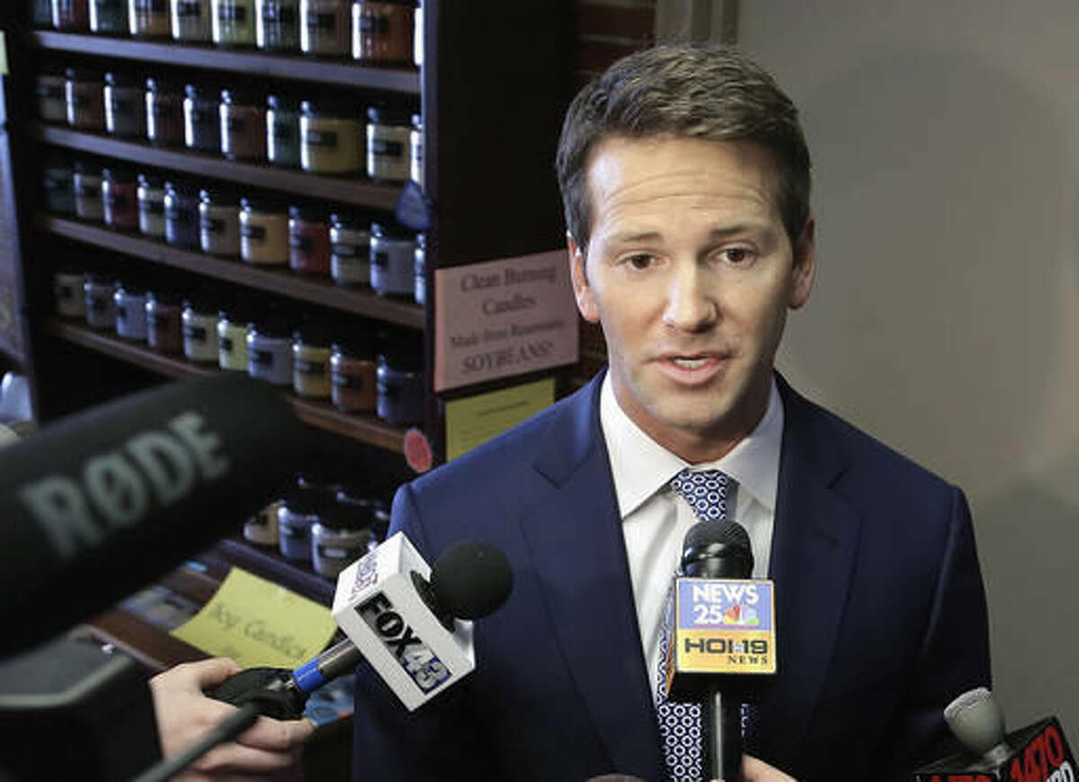 FILE - In this Feb. 6, 2015, file photo, former U.S. Rep. Aaron Schock, R-Ill. speaks to reporters in Peoria, Ill. A federal indictment charges Schock with allegedly using government and campaign money to subsidize a lavish lifestyle, included an allegation that he also pocketed thousands of constituent dollars. Prosecutors say Schock hosted expensive Washington meet-and-greets, charged a fee and secretly kept some of the cash. State political observers say the alleged scheme stands out, even with Illinois' long-established reputation for corruption. (AP Photo/Seth Perlman, File)