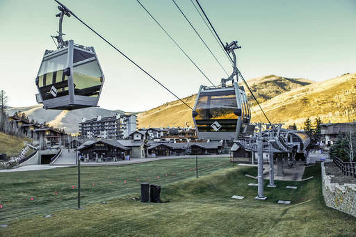 FILE - This Tuesday, Nov. 15, 2016 file photo shows a gondola lift at the Vail Ski Resort in Vail, Colo. Ski resorts in Wyoming, Idaho, Colorado, New Mexico and Utah have been forced to delay opening for the Thanksgiving holiday weekend or have few ski runs open because unseasonably warm weather limited their ability to make man-made snow. (Chris Dillmann/Vail Daily via AP, File)