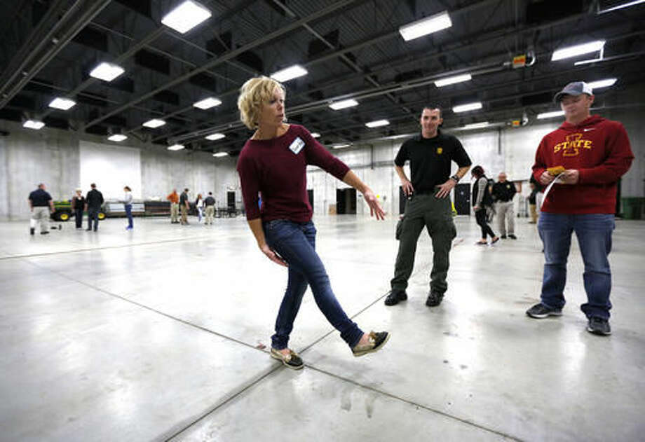 ADVANCE FOR USE SATURDAY, NOV. 19, 2016, AND THEREAFTER- In this Nov. 8, 2016, photo, Volunteer Megan McKenna takes a field sobriety test as multiple law enforcement agencies participated in field sobriety evaluation training at the Dubuque County Emergency Responder Training Facility in Dubuque, Iowa. (Mike Burley/Telegraph Herald via AP) Photo: Mike Burley