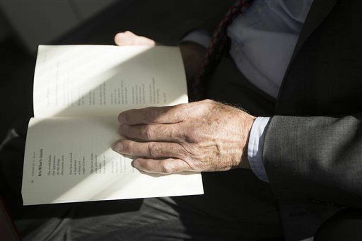 """Second District Court Judge Thomas L. Kay reads some of his poems and talks about their inspiration at the Second District Court House in Bountiful, Utah, Monday, Oct. 31, 2016. Judge Kay recently published a collection of his poems called """"The Road I've Taken."""" (Briana Scroggins/Standard-Examiner via AP)"""